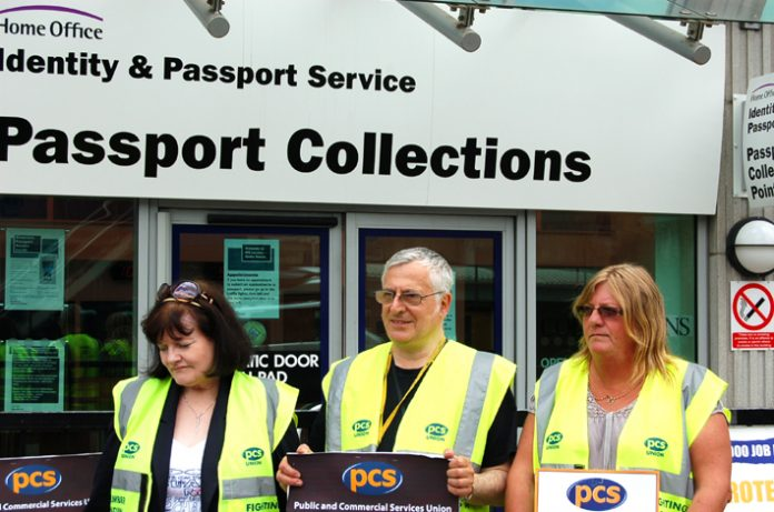Pickets outside passport office in Victoria, central London, yesterday on the first day of their three-day strike