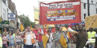 North East London Council of Action banner leads the 1,000-strong march through Enfield Town
