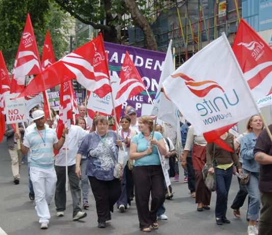 Unite members marching against pay cuts during July's national strike by local government workers