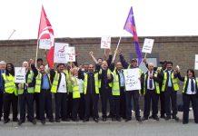 Defiant striking busworkers outside the Lea  Interchange garage in north London yesterday