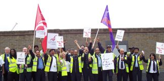 Defiant striking busworkers outside the Lea  Interchange garage in north London yesterday