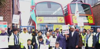 Striking bus workers fighting for fair pay outside Alperton bus garage yesterday morning