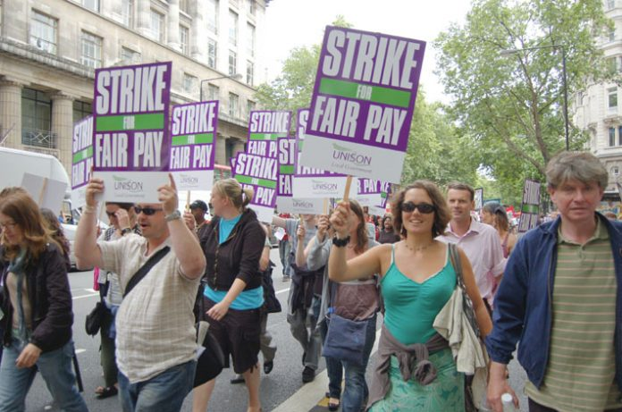Striking council workers marching against the Brown government's pay cuts in London in July
