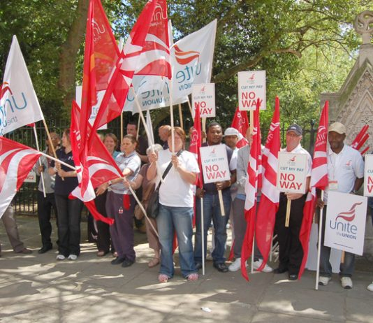 Members of Unite assemble for a demonstration in central London during national strike action by local government workers in July