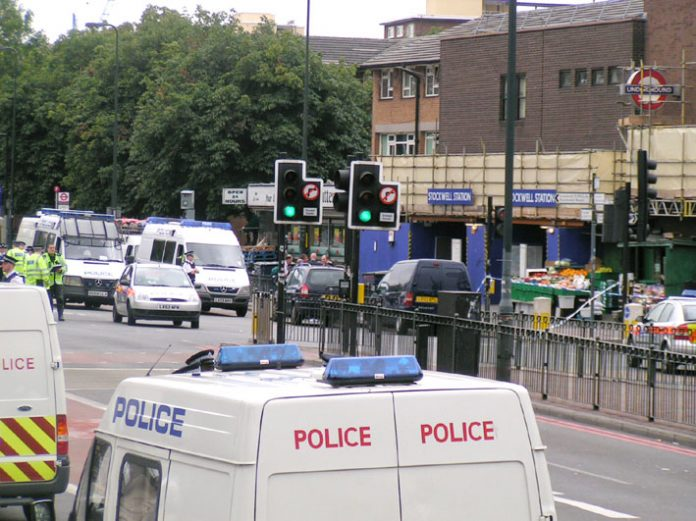 Police surround Stockwell tube station after armed officers brutally executed Jean Charles de Menezes on July 22, 2005