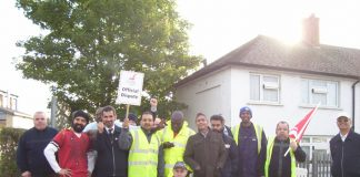 Busworkers on the picket line yesterday at greenford garage – determined to fight for the same pay for all busworkers