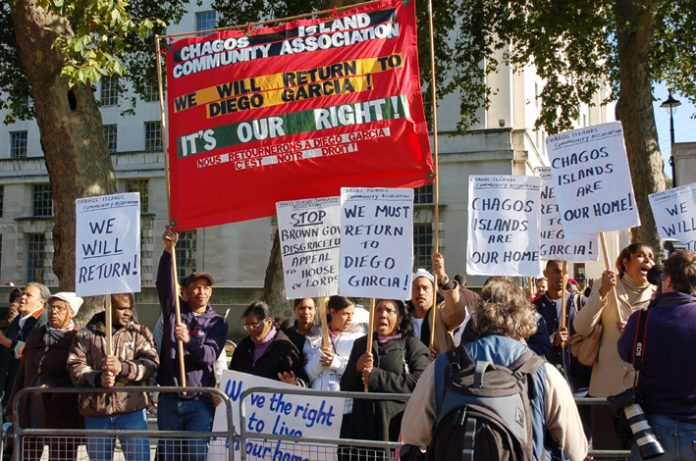 Angry Chagossians with their banner demanding return to Diego Garcia as they picket Downing Street