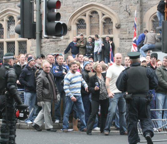 Loyalists opposed to the Sinn Féin protest parade against the British army in Belfast