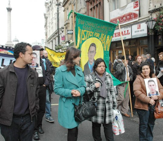 MARIA OTONE DE MENEZES (right) holds a picture of her son Jean Charles de Menezes on the United  Friends and Families Campaign demonstration on October 25