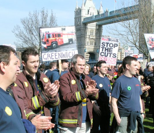 Firefighters demonstrating against cuts to the fire service in London. Their union warns that the cuts are endangering lives