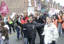 Postal workers and their families marching in Crewe on October 25 demanding the Mail Centre be kept open