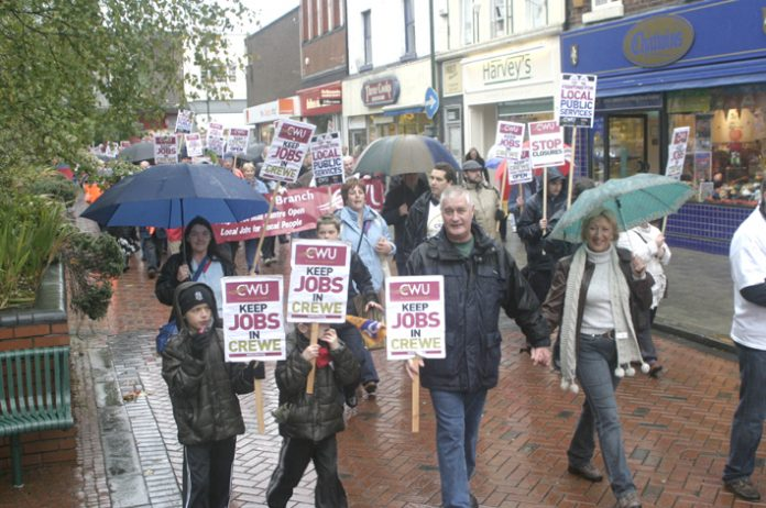 Postal workers and their families  marching through Crewe demanding that the Mail Centre be kept open