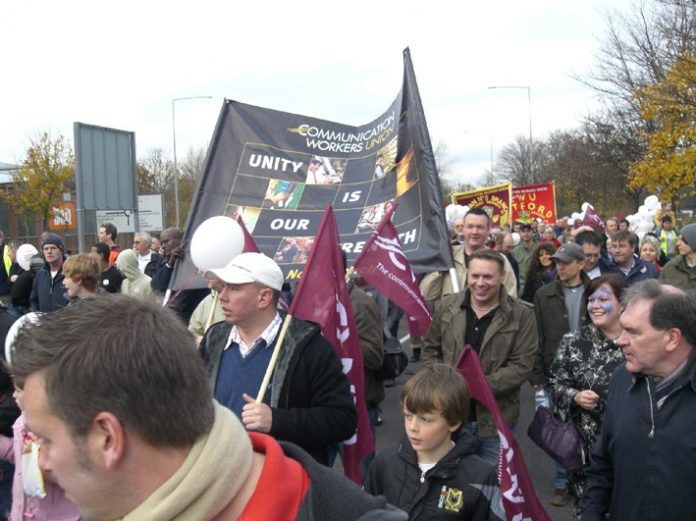 A section of the 300-strong march of postal workers, their families and supporters defending the Milton Keynes Mail Centre on Saturday