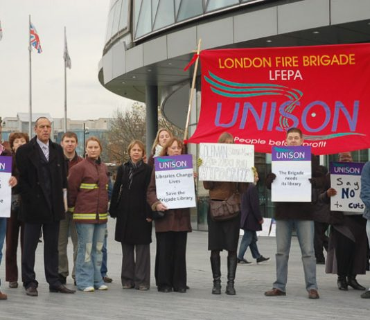 London fire service staff outside City Hall yesterday to demand the withdrawal of threatened cuts