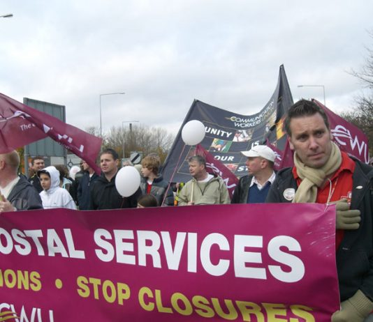 Royal Mail workers marching through Milton Keynes against plans to close their Mail Centre and condemning the Brown government for its privatisation policies
