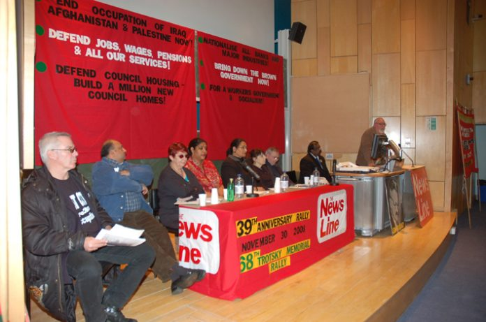 The platform at the News Line Anniversary Rally. Left to right: Hank Roberts, Vally Wilson, Zina Dodgson, Lakhinder Saran, Sheila Torrance (chair), Paddy O'Regan, Nimalan Sevaranam and Dave Wiltshire (ATUA National Secretary, speaking)