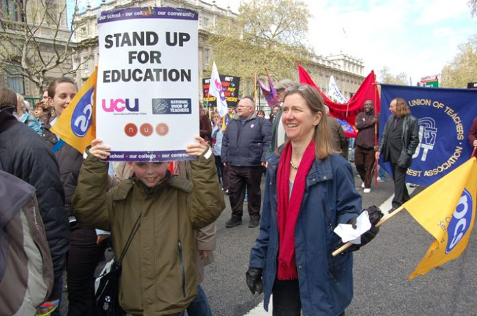 UCU members marching with NUT and PCS members during the strike action over pay on April 24th