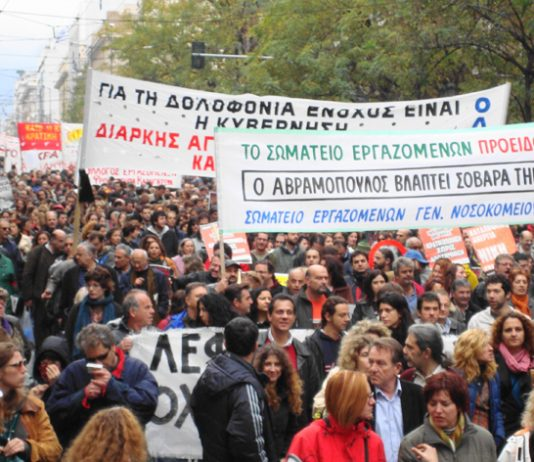 Greek workers marching through Athens during the nationwide revolt that continued into a third week yesterday
