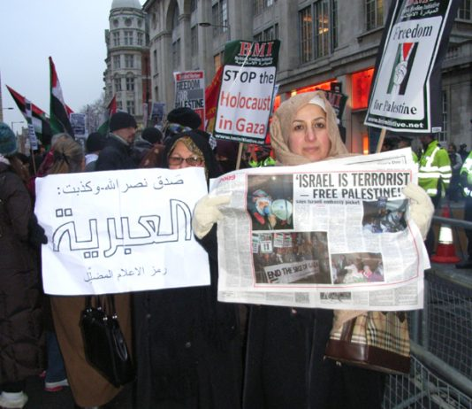 Demonstrators hold up the News Line which perfectly expresses their feelings about the terrorist state of Israel
