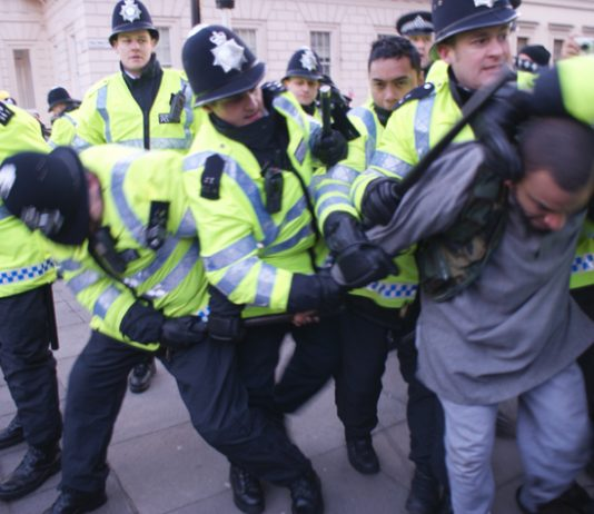 Police brutally arrest a demonstrator during last Saturday's march against the Israeli  atrocities in Gaza