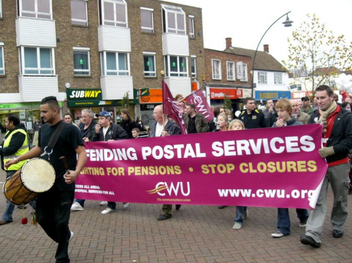 Milton Keynes Mail Centre workers march to defend jobs. Royal Mail is threatened with privatisation