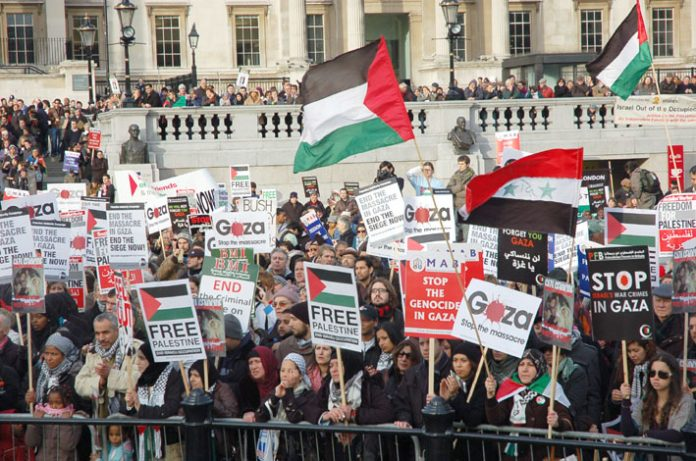 A section of the 10,000-strong rally for a free Palestine at Trafalgar Square on Saturday