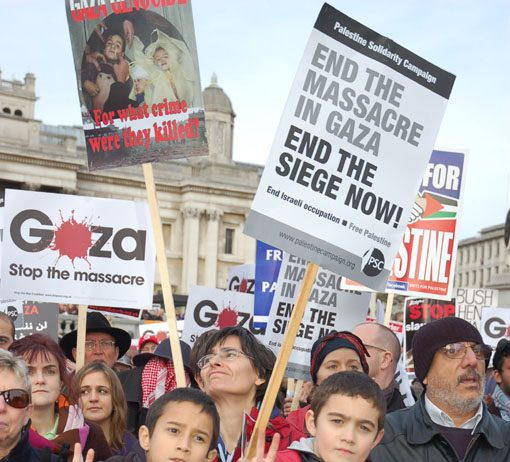 Young demonstrators during a mass protest in Trafalgar Square on Saturday against the Israeli war on Gaza, shortly before Israel announced it would withdraw