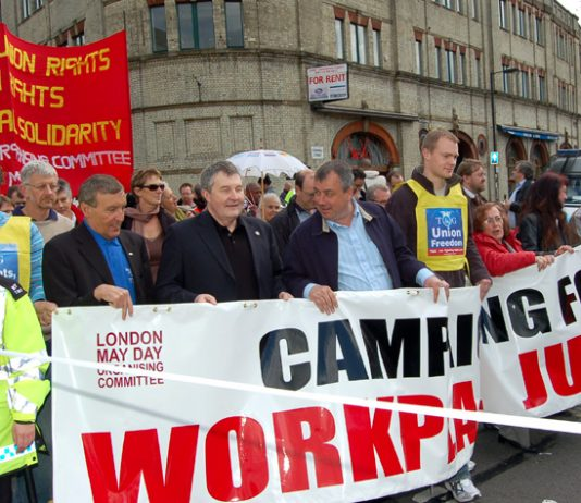 Unite leaders WOODLEY and SIMPSON (left of picture), on the London May Day march, were yesterday unable to give a