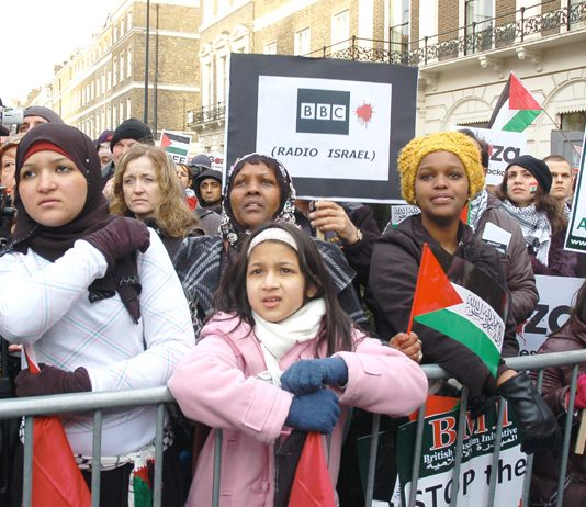 'BBC Radio Israel', says a placard, during Saturday's protest against the BBC refusal to broadcast an emergency aid appeal.