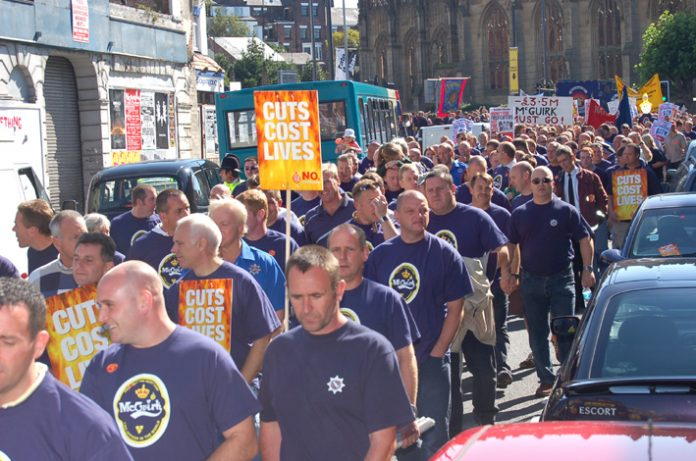 Merseyside firefighters marching in Liverpool in September 2006 during their strike action against cuts