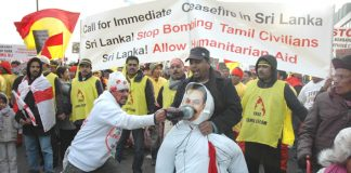 A Tamil marcher bashes an effigy of Sri Lankan President Rajapakse with his shoe – More than 120,000 Tamils and their supporters marched in London on Saturday to demand a halt to the shelling of Tamil areas in northern Sri Lanka and no more UK support for