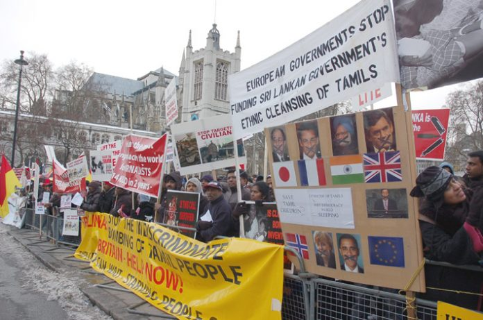 Demonstrators in Parliament Square held banners and placards condemning the silence of world leaders