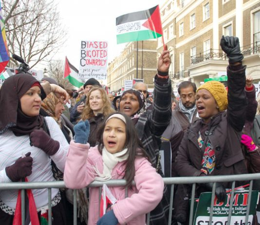 Demonstrators against the Israeli bombing of Gaza condemn the BBC for its refusal to broadcast an appeal for aid for Gaza