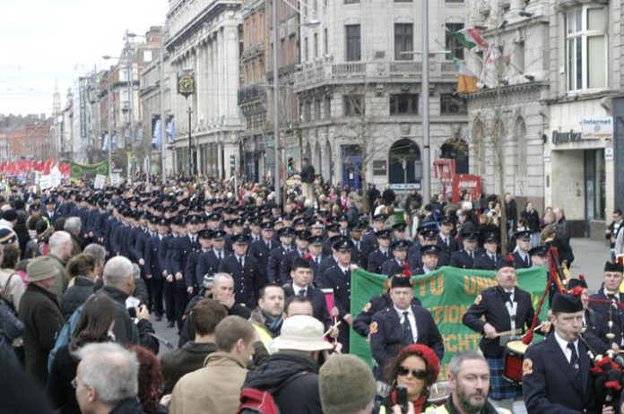 Fire officers and fire crews head the huge march down O'Connell Street