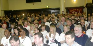 A section of the audience applauding the call for strike action