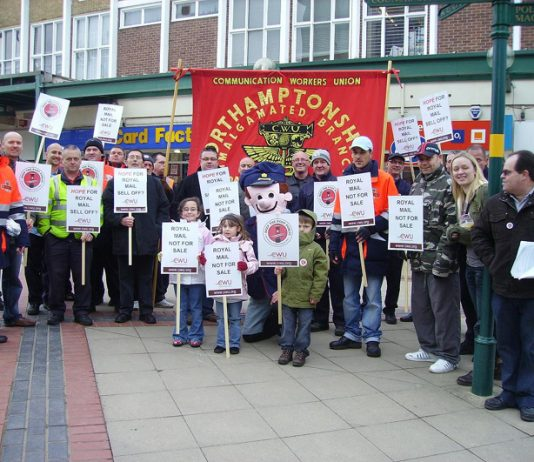 Northamptonshire postal workers demonstrating outside the surgery of Corby MP Phil Hope, after Hope reneged on a commitment to oppose the part-privatisation of the Royal Mail