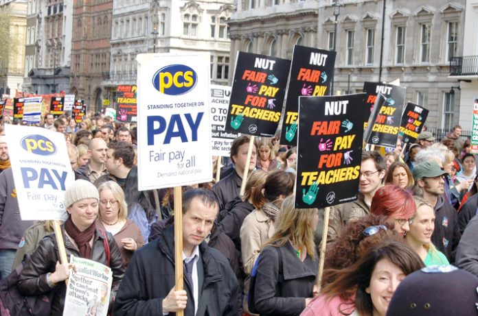 Local government workers marching in London during the national pay strike of the NUT, PCS and UCU unions