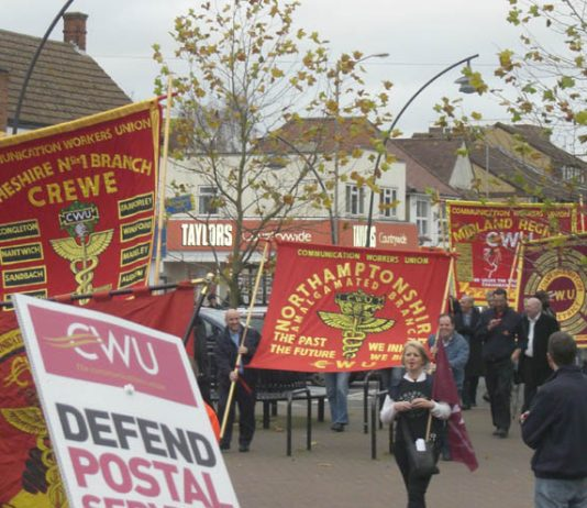 Northamptonshire CWU banner on the march to keep open Milton Keynes Mail Centre