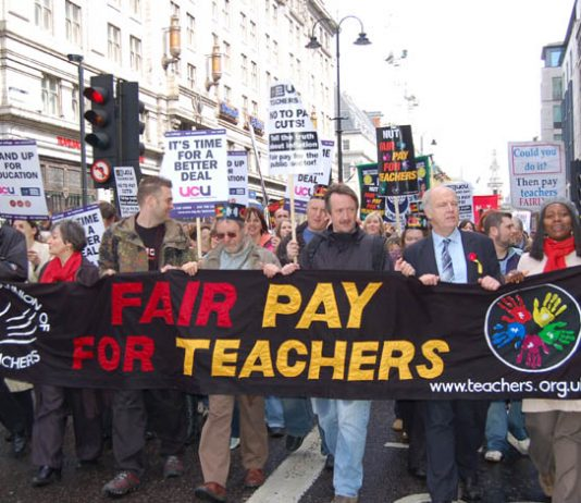 Teachers marching for fair pay during national strike action in April last year