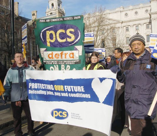 Civil servants marching in Whitehall against the onslaught on their jobs