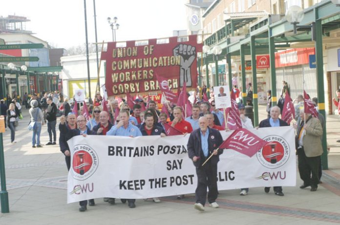 Post workers  were applauded  as they marched through Corby town centre
