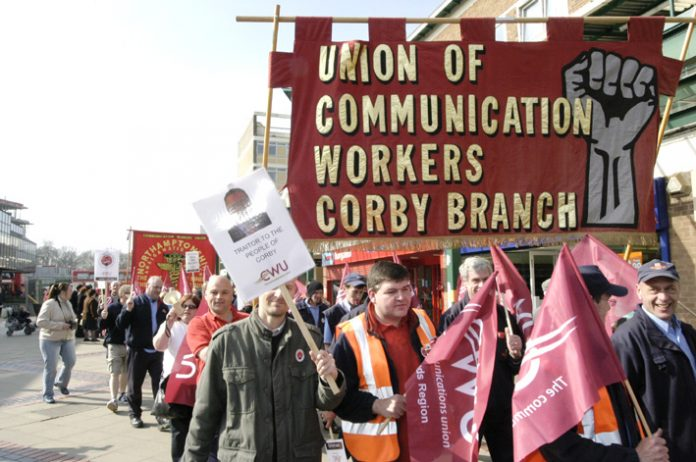 Royal Mail workers marching against privatisation that will mean mass sackings