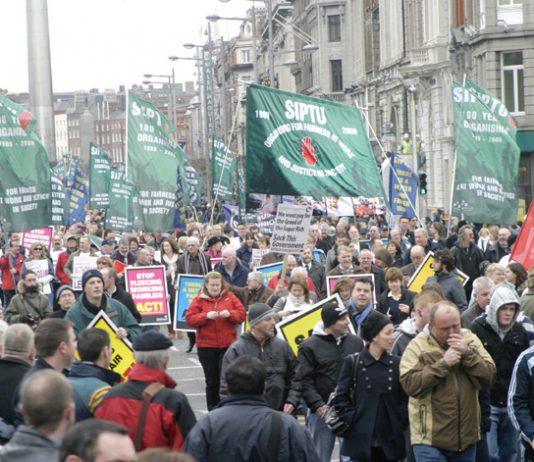 SIPTU banners on the 125,000-strong demonstration in Dublin on February 21 against wage cuts and job losses