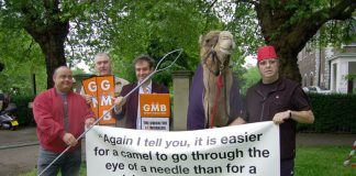 GMB members with a camel protest outside a church in Clapham against Damon Buffini, the head of the Permira venture capitalist group which owned the AA at the time