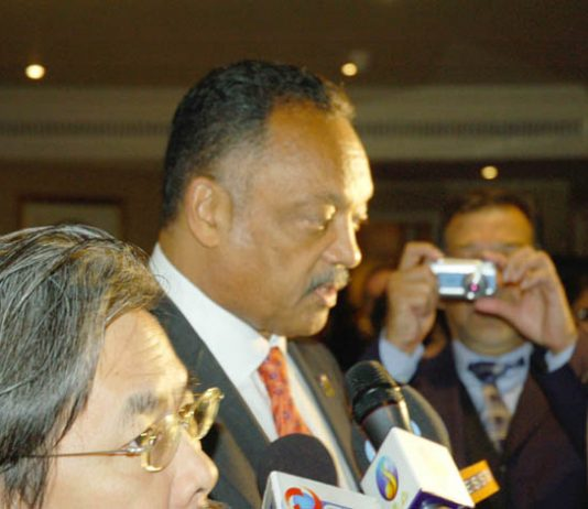 Jesse Jackson (centre) leaving the World Tamil Conference in London on Thursday