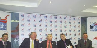TONY WOODLEY (centre) enjoying a joke with bosses' leader Lord DIGBY JONES who wants to see workers on a two-day week