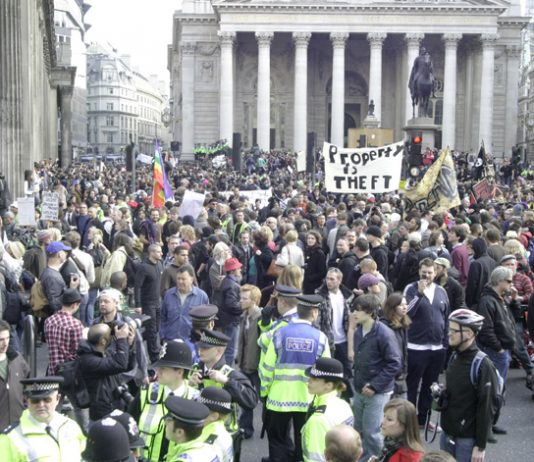 'Property is theft' banner amidst thousands of protesters outside the Bank of England