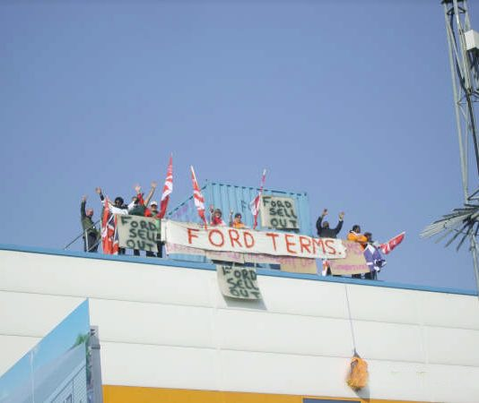 Workers occupying the roof of the Visteon factory in Enfield yesterday