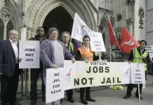 Unite members outside the High Court yesterday demonstrating for jobs and opposing the attempt to jail the leaders of the Enfield occupation