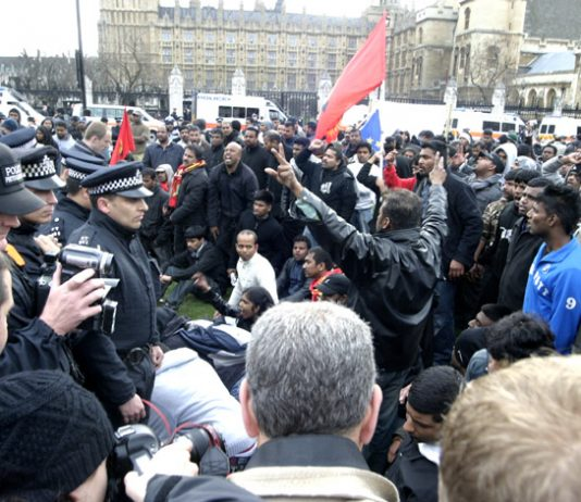 Angry Tamils confront police in Parliament Square after being forcibly removed from Westminster Bridge